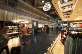 FILE: Passengers walk past shops in Terminal B. Current businesses and potential tenants are included in decision-making for the future of KCI.