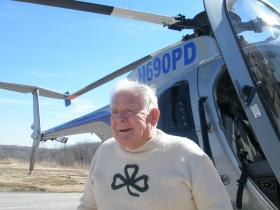 Jack Brady, Kansas City, Missouri Police Captain, retired. Brady is exuberant  after long awaited modern copter ride.