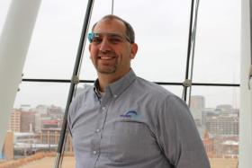 """Engage Mobile's Darrin Clawson models one of the four pairs of Google Glass. He and his team have been """"living Glass"""" for about a year."""