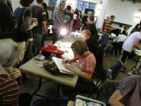 The Monster Drawing Rally features artists drawing for an hour before selling their creations to benefit a scholarship fund.