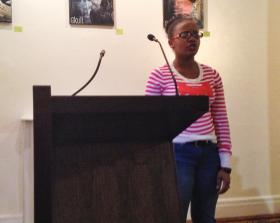 Stacy Lafontant recites 'America' by Claude McKay. Stacy is from Haiti, and says she relates to McKay because they have the shared experience of being from another country.