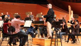 Music director Michael Stern wears the Glass during a rehearsal of Beethoven's Fifth Symphony.