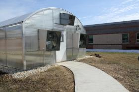 Students at Waukon High School in Iowa grow carrots, tomatoes, lettuce and other vegetables for school lunches in an on-campus greenhouse.
