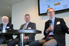 David Toland (right), executive director of Thrive Allen County, spoke at a health forum in Kansas City, Kan., on Monday. Looking on were Joe Connor (center) of Wyandotte County government, and Tim Norton of Sedgwick County.