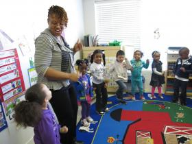 Preschool teacher Twakisha Jones leads her class in a song.