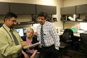 Dr. Prabhu Parimi (right), medical director of the Neonatal Medical Home at the University of Kansas Hospital, conferred with nurse coordinator Brittany Glynn and Dr. Vishal Pandy, a neonatologist.