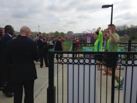 Runners help celebrate opening a bridge across Brush Creek, the final project of a $50 million federal infrastructure grant.