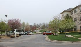 On Monday, police tape was still wrapped around a parking lot at Village Shalom in Overland Park, Kan. to keep visitors out of the crime scene.