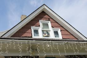 This Mickey Mouse sign on display in an upper window of the house at 3028 Bellefontaine Ave. in Kansas City is one of the only indicators that the house has any Disney ties.