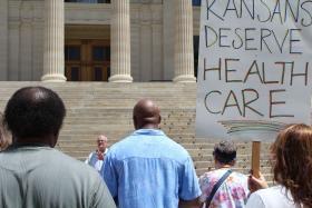 Rep. Jim Ward, a Wichita Democrat, spoke on Friday to supporters of Medicaid expansion in front of the Kansas Statehouse.