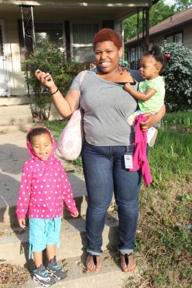Kara McGowan , Addison, and baby Airis ready to walk the few blocks to the bus stop.