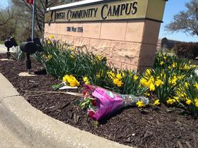 Mourners left flowers at the Jewish Community Center in Johnson County, Kan., after shootings took the lives of three people on April 13.