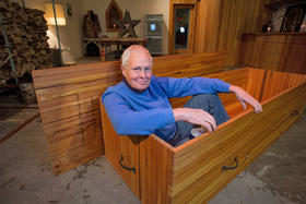 Dr. Jeff Piehler sits in his coffin at the workshop.