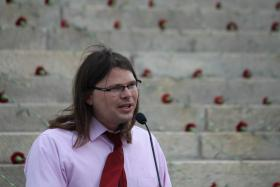 Josh Longbottom, pastor of the Central Congregational Church in Topeka, challenged Gov. Sam Brownback and other legislators to embrace Medicaid expansion as a way to help poor Kansans. Longbottom spoke Friday during a rally outside the Capitol.