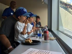 Twin brothers Camden and Preston Tyrrell watch the Royals with their father, Chris.