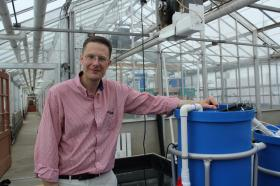 At Iowa State, Rosentrater's interest in biosystems extends from fish feed production to aquaponics, which he studies in this greenhouse on campus.