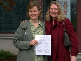 A couple holds their marriage license in Iowa, a state where same-sex couples can go to get legally married.
