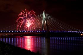 KC Riverfest fireworks light up the Missouri River next to the Christopher Bond Bridge to celebrate the Fourth of July.