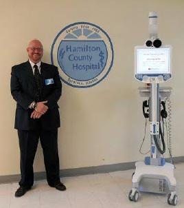 Hamilton County Hospital CEO Bryan Coffey and the robot.