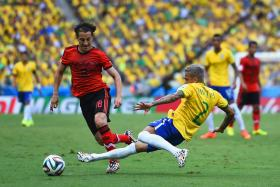 Players from Brazil and Mexico play at the 2014 World Cup.