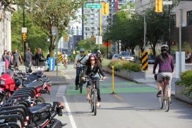Eric Bunch, Director of Education at BikeWalk KC, believes that Kansas City needs to install more dedicated cycle tracks, similar to this one in Vancouver, Canada, to inspire more people to utilize bike transportation in Kansas City.