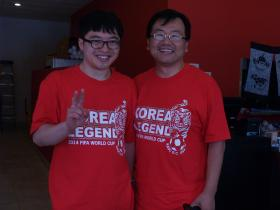 Gwon Cheol Paek (left) and Sejun Song (right) show off their Korea team t-shirts as they watchi the Korea soccer team play Algeria at Chopsticks restaurant in Overland Park, Kan.