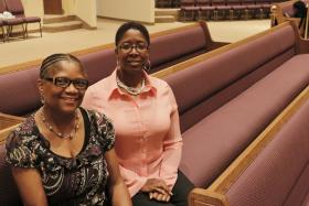 LaTrischa Miles (left) and Yvonne Richmond were two of the women who organized the Taking it to the Pews AIDS-awareness project at Mt. Carmel Church of God in Christ in Kansas City, Kan.