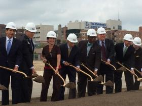 Business and civic leaders break ground for the new Truman outpatient center on Hospital Hill.