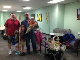 Members of KC DADS visit the KCUR studios with their kids.