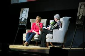 Former Secretary of State Hillary Clinton speaks with Rainy Day Books co-owner Vivien Jennings at the Midland Theater on June 21, 2014.