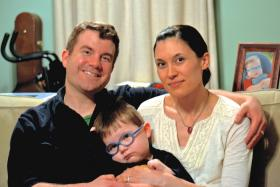 Ryan and Kathy Reed recently moved from Kansas to Colorado hoping that a marijuana extract legally available in there will help control their son Otis' epileptic seizures.