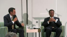 Kansas Republican Congressman Kevin Yoder, left, teases Missouri Democratic Congressman Emanuel Cleaver about almost missing a flight home. The two were promoting a new group that encourages people from different political parties to meet.