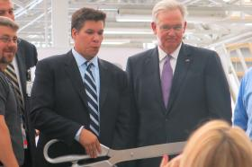 Aviation Technical Services President and CEO Matt Yerbic, left, and Missouri Gov. Jay Nixon cut the ribbon at the company's new hangar at Kansas City International Airport.
