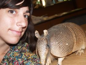 Reporter Suzanne Hogan takes a 'selfie' with a stuffed armadillo at the Discovery Center on Troost Avenue in Kansas City, Mo.