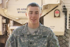 Army Specialist Isaac Sims seen here in a holiday greeting sent from Ramadi, Iraq in 2009.
