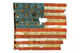 The Star-Spangled Banner, the flag that inspired the lyrics to our national anthem, is on display at The Smithsonian in Washington, DC.