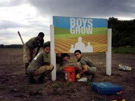 Boys Grow kids getting their hands dirty on their farm.