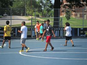 Children play a game of futsal soccer, which involves fewer players and a smaller field, at Wyandotte High School.