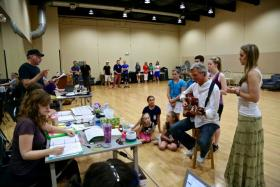 """From left, Director Philip Wm. McKinley talks to """"The Sound of Music"""" cast members, including Tom Galantich as Captain von Trapp (center) and Analisa Leaming as Maria (at right) during a rehearsal."""