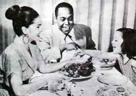 Kim Parker (right) with her mother, Chan Parker, and Charlie Parker.