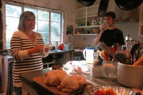 Carol Kelly, left, talks to her son Conner while making dinner. The Kellys live in Brookside and send their kids to Kansas City Public Schools.