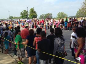 Hundreds of families line up for school supplies at a back-to-school fair at Kansas City Kansas Community College last week.