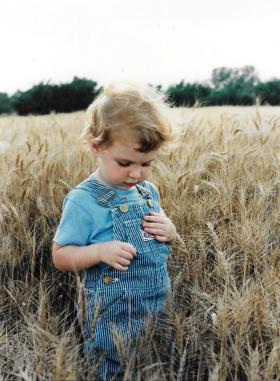 Then-two-year-old Emily Robbins in her father's wheat field in central Kansas.