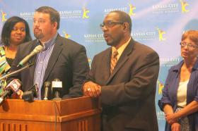 Kansas City Public Schools Board of Directors President Jon Hile, left, and Superintendent Stephen Green announce the district's provisional accreditation status.