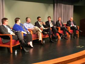 U.S. Rep. Kevin Yoder, center, speaking at a forum on federal biomedical research.