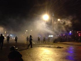 Tear gas, shown here streaming in Ferguson, Mo., earlier this week, was one of law enforcement's crowd-control measures amid looting and riots in the wake of the police shooting of an unarmed 18-year-old in the St. Louis suburb.