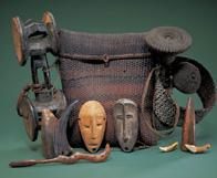 Initiation basket and contents.  Plant fiber, wood, ivory, animal teeth, animal horn and buttons.  Height: 13-3/8 in.