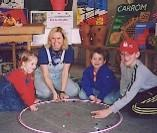 Cathy Runyan-Svacina and kids playing marbles