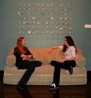 "Sarah Diehl and Jaime Sanders under Joe Walter's ""Mesh 84\"" (2001)at the Spencer Museum of Art."