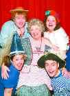 "Bonita Hanson (center) plays the title role in Theatre for Young America's ""The Magic Mrs. Piggle-Wiggle.\"" The show's cast of \""kids\"" include (clockwise from upper left) Parry Luellen, Sarah Homan, Seth Golay and Jessica Dressler."